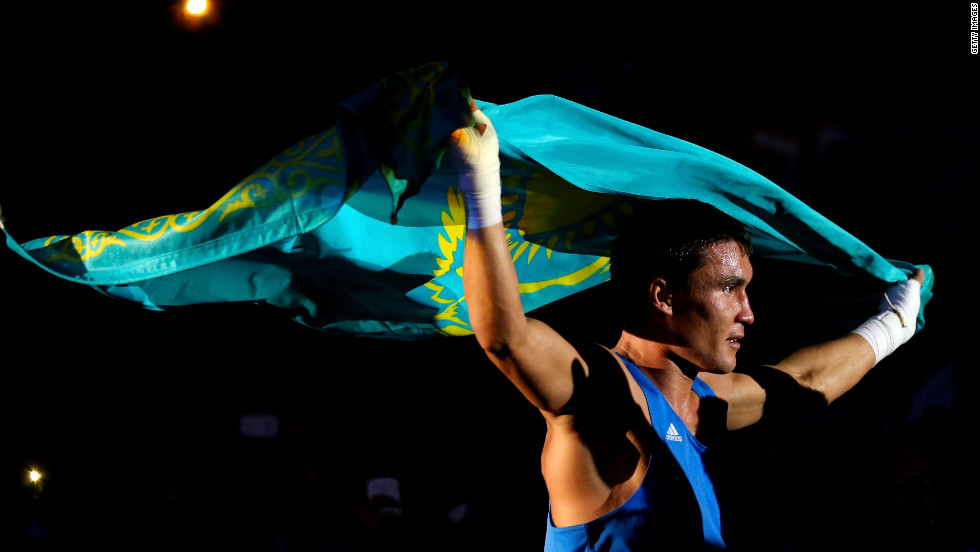 Kazakhstan boxer Serik Sapiyev enjoys the thrill of victory after defeating Freddie Evans of Great Britain in the men's welter 69-kilogram boxing final bout.