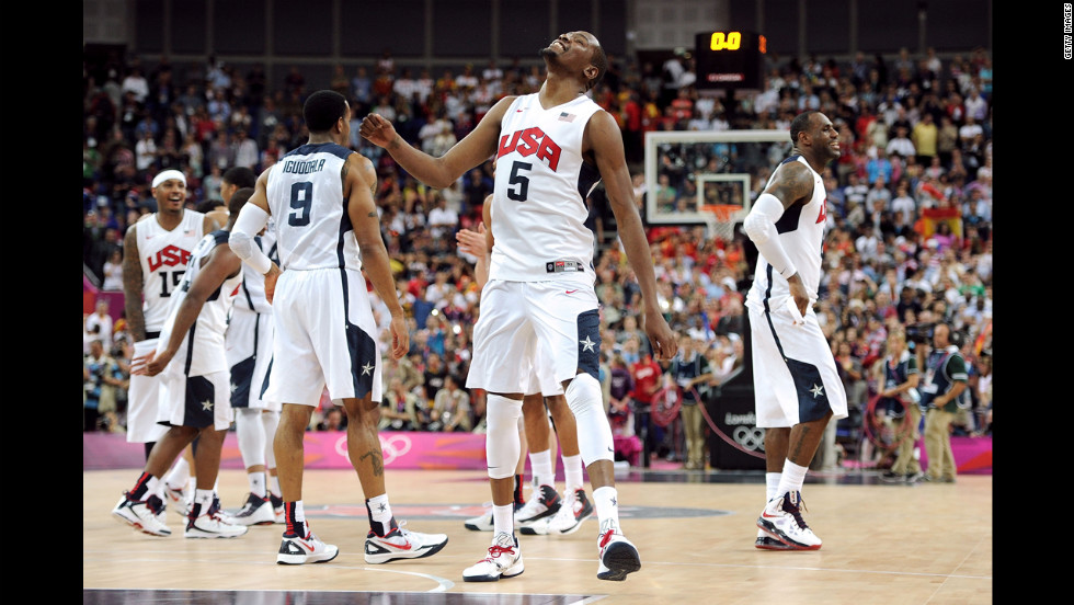 Kevin Durant, center, is triumphant at the end of the gold medal match against Spain on Sunday.