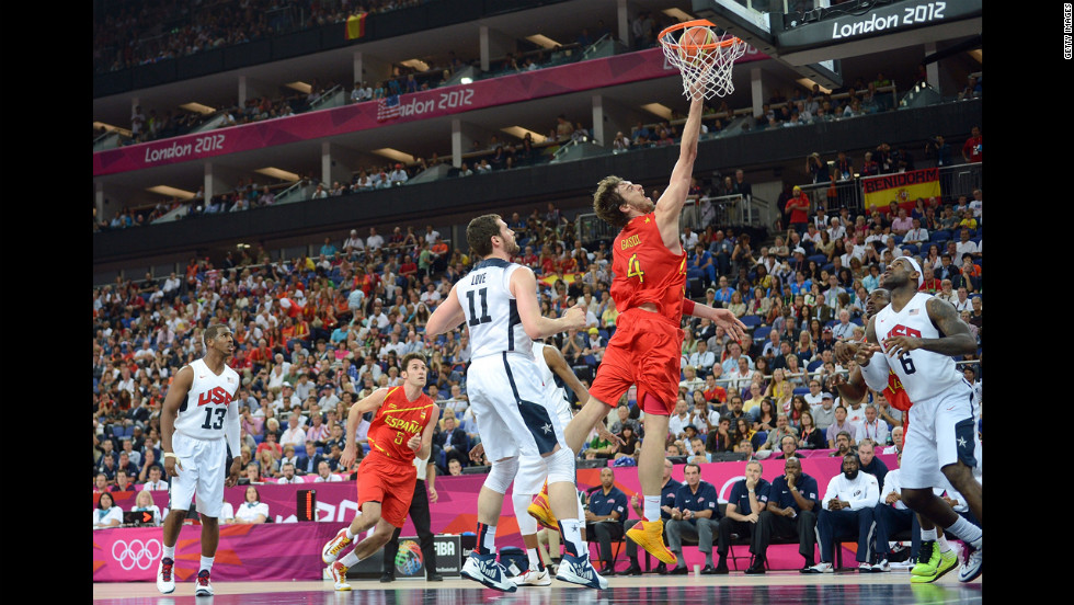 Pau Gasol of Spain drives past Kevin Love of the United States.