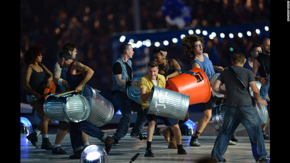 Members of the British percussion group Stomp pound trash cans during their performance.