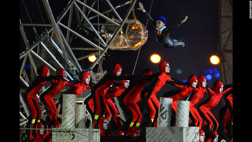 Artists perform at the Olympic stadium.