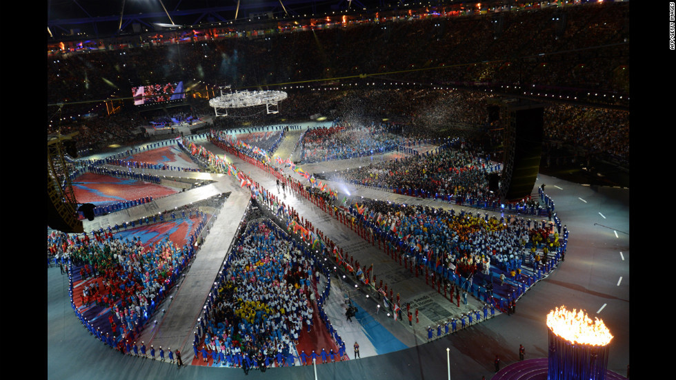 Athletes form a living Union Jack on the floor of Olympic stadium.