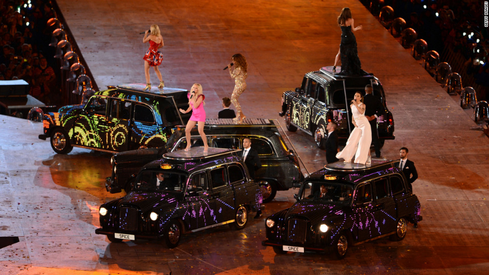 From left, Geri Haliwell, Emma Bunton, Melanie Chisholm, Victoria Beckham and Melanie Brown of the Spice Girls reunite for the closing ceremony.