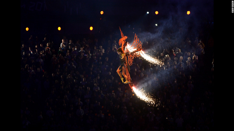 Ballet dancer Darcey Bussell descends into the stadium on a phoenix.