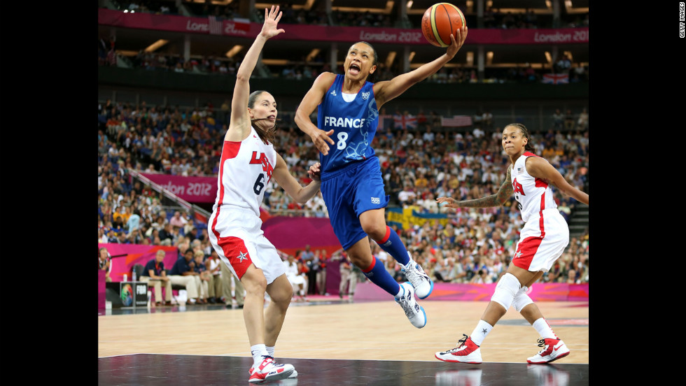 Edwige Lawson-Wade No.8 of France goes up for a shot against Sue Bird No.6 of United States in the second half during the Women's Basketball Gold Medal game.