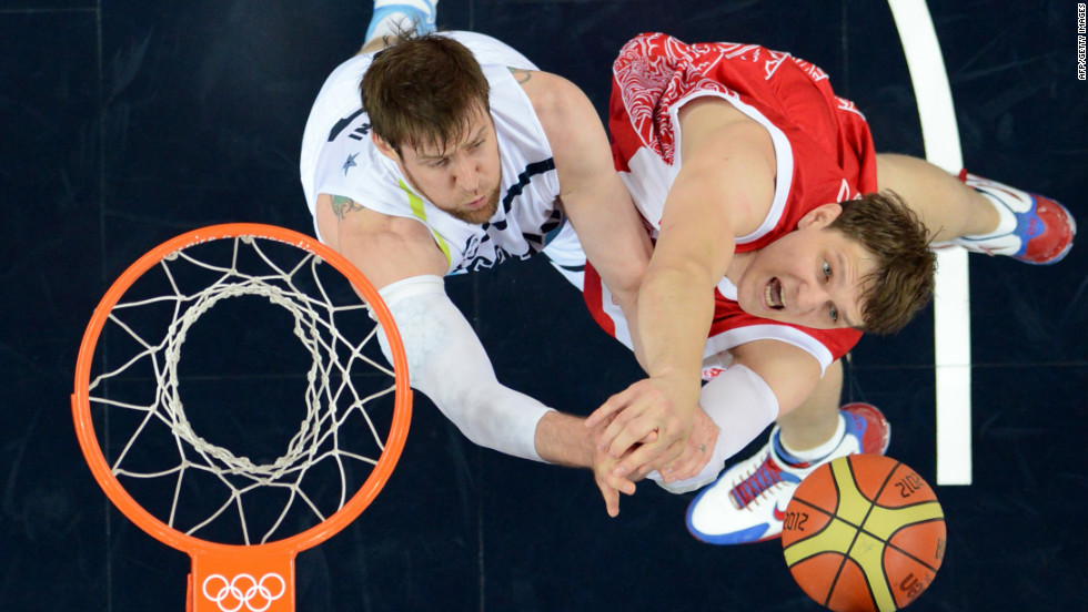 Argentinian forward Andres Nocioni, left, challenges Russian center Timofey Mozgov during the men's bronze medal basketball game at the North Greenwich Arena. Russia won 81-77.