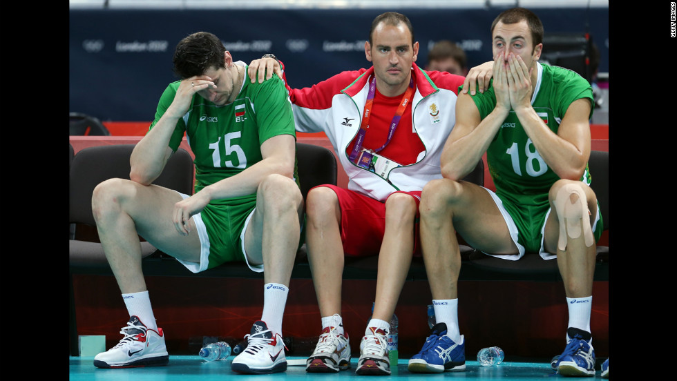 Dejected Bulgarian players look on during their loss to Italy in the men's volleyball bronze medal match.
