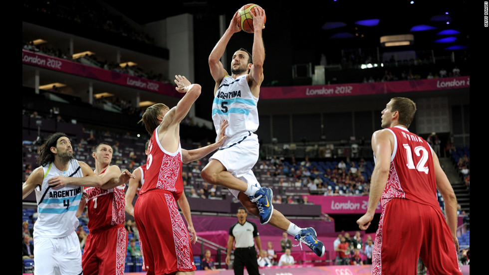 "Manu Ginobili, center, of Argentina drives down the lane during the men's basketball bronze medal game against Russia. See photos from the <a href=""http://www.cnn.com/2012/08/12/world/gallery/olympic-closing-ceremony/index.html"" target=""_blank"">closing ceremony.</a>"