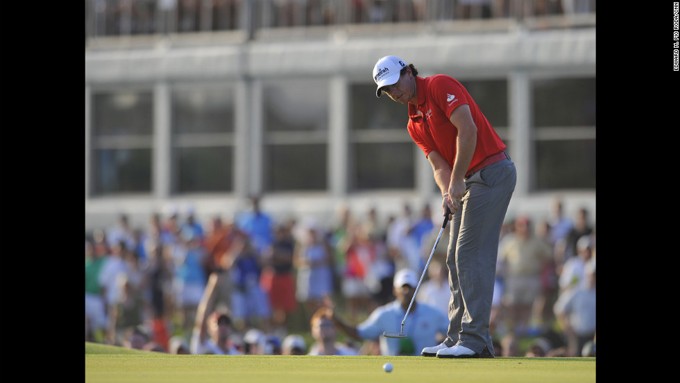 Rory McIlroy sinking the winning putt.
