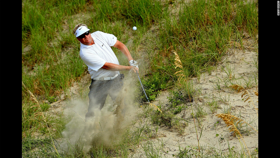 Carl Pettersson of Sweden hits out of the sand on the 10th hole.