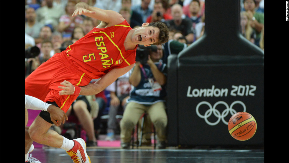 Spain's Rudy Fernandez is thrown off by the sudden lurch of the arena.