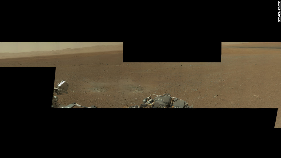 "This partial mosaic from the Curiosity rover shows Mars' environment around the rover's landing site on Gale Crater. NASA says the pictured landscape resembles portions of the U.S. Southwest. The high-resolution mosaic includes 130 images, but not all the images have been returned by the rover to Earth. The blackened areas of the mosaic are the parts that haven't been transmitted yet. <a href=""http://mars.jpl.nasa.gov/msl/multimedia/images/?ImageID=4421"" target=""_blank"">See more on this panaroma on NASA's site.</a>"