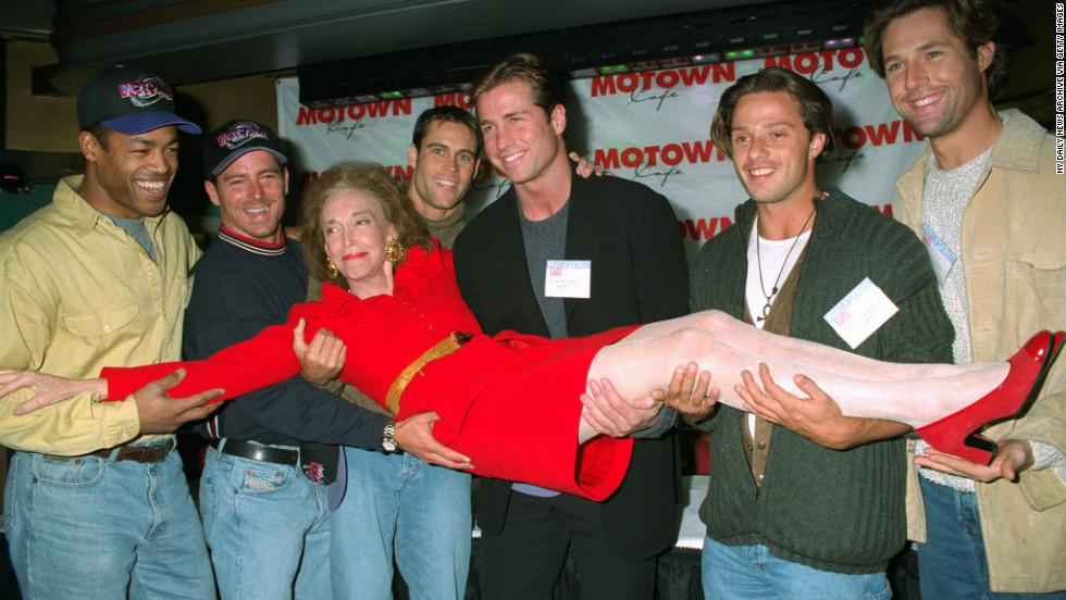 "Cosmopolitan's ""bachelor of the month"" calendar hunks carry editor Gurley Brown into the Motown Cafe in 1996. From left: Dan Herndon, Shawn Maratea, Thom O'Brien, Kirk Williams, Vinny Lamantia and David Goldman. Gurley Brown left the magazine in 1997 to become editor-in-chief of its 64 international editions."