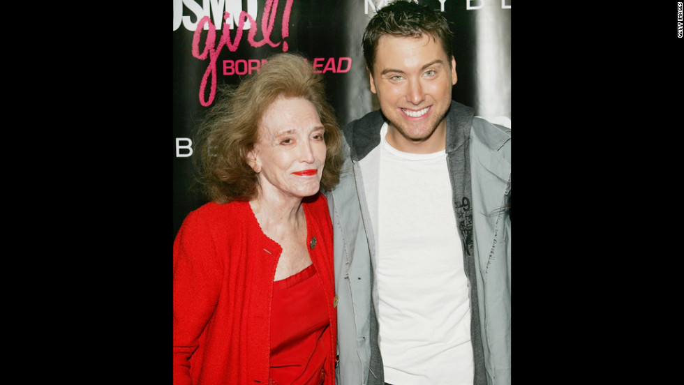 Singer Lance Bass poses with Gurley Brown in 2006 at CosmoGirl's Born To Lead Awards in New York.