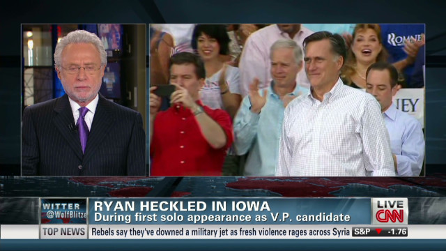 Ryan stumps, heckled at Iowa fair