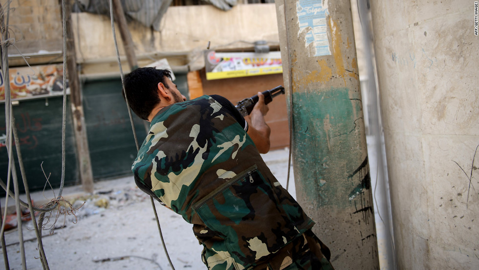 A rebel fighter fires at government forces Monday in Aleppo's Salaheddin neighborhood.