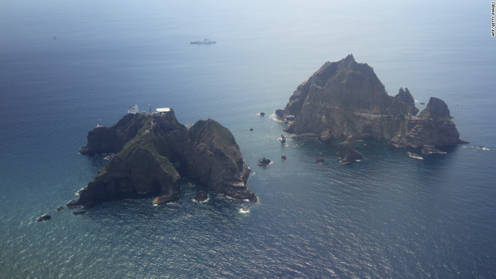 An aerial view of the remote islands disputed with Japan taken on August 10, 2012. According to a South Korean website on the islands, Dokdo has a population of three and amid the craggy rocks sit a lighthouse, lodge, helicopter landing pad, and a police station manned by South Korean officers.