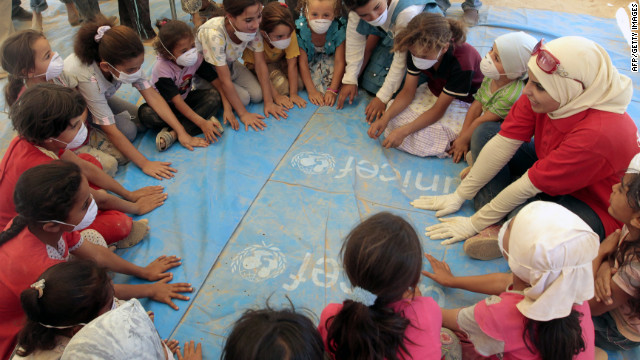 Syrian refugee children playing on Saturday in a tent at the Zaatari refugee camp in Jordan.