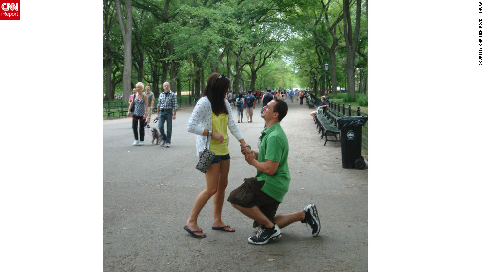 "On a day trip to New York in 2010, Christen Mishura and now-husband Corey Mishura, took a stroll in Central Park. As they prepared to have a stranger take a snapshot, Corey got down on a knee with a ring box in hand. ""Public proposals definitely add an element of fun to the pressing question at hand,"" she said.  <a href=""http://ireport.cnn.com/docs/DOC-826860"" target=""_blank"">See more about the proposal on Christen Mishura's iReport</a>."