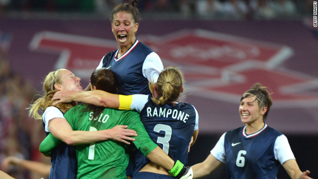 Midfielder Shannon Boxx, top, celebrates with teammates winning gold against Japan on August 9, 2012, in London.