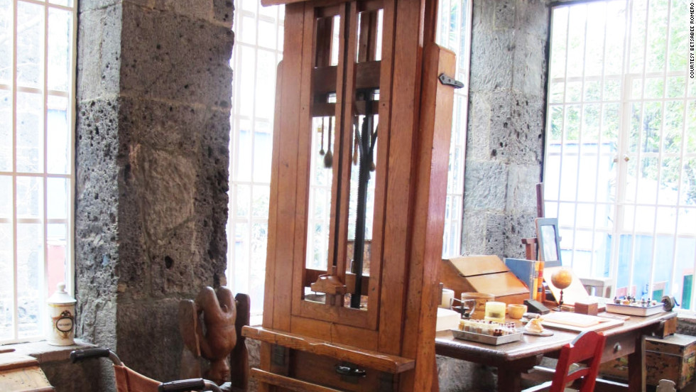 In her studio at Casa Azul, Frida Kahlo's wheelchair is positioned in front of an easel purportedly given to her by Nelson Rockefeller.