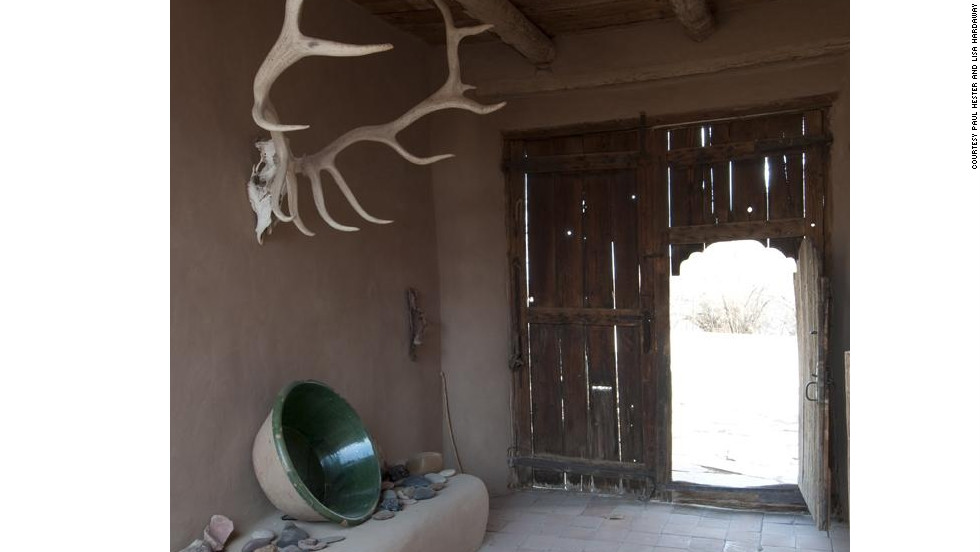 The wooden door to Georgia O'Keeffe's house in Abiquiu, New Mexico, opens into this adobe zaguan (vestibule).