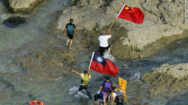 Activists carry Chinese and Taiwan flags on the disputed island known as Senkaku in Japan and Diaoyu in China Wednesday.