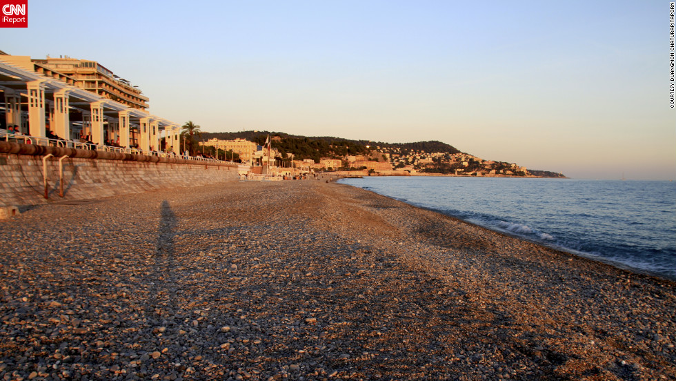 "Duangmon Chaturapitaporn <a href=""http://ireport.cnn.com/docs/DOC-829157"">captured this image</a> at sunset on the beach along Nice's Promenade des Anglais."