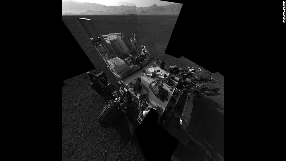 An updated self-portrait of the Mars rover Curiosity, showing more of the rover's deck. This image is a mosiac compiled from images taken from the navigation camera. The wall of Gale Crater, the rover's landing site, can be seen at the top of the image.