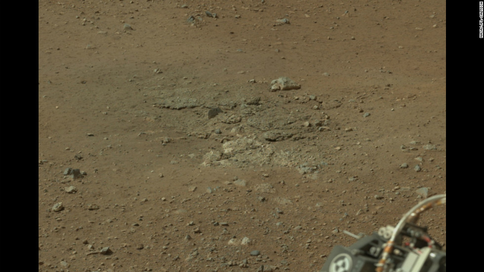 This image, cropped from a larger panorama, shows an area, near the rover's rear left wheel, where the surface material was blown away by the descent-stage rockets.