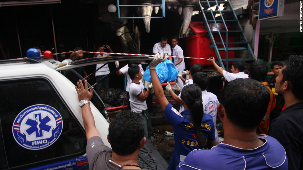 "Emergency staff carry out victims of a fire that swept through the Tiger Bar club in Patong, Phuket, Thailand on Friday, August 17, 2012Photo courtesy of <a href=""http://phuketwan.com/"" target=""_blank"">Phuketwan.com</a>"