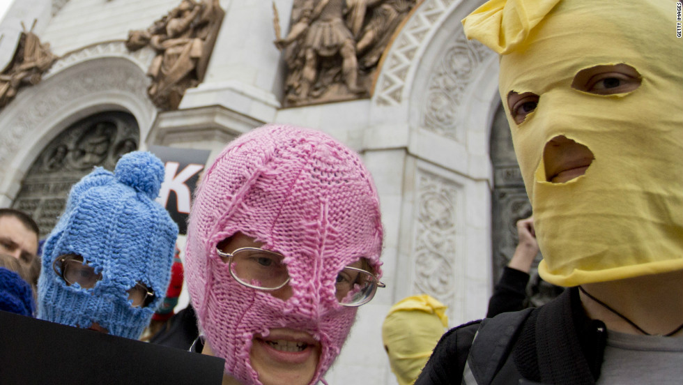 Campaigners wear the band's trademark colorful balaclavas in a demonstration outside the Church of Christ the Savior in Moscow.