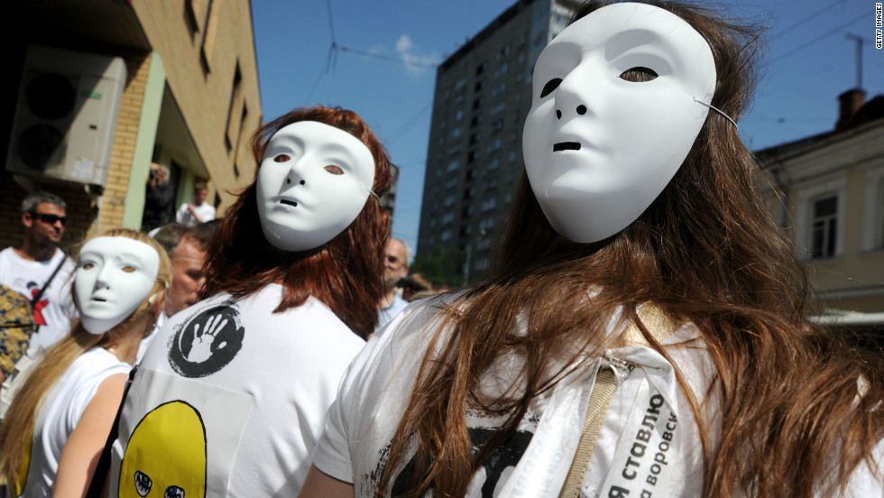 "Demonstrators wear Pussy Riot-style masks outside a Moscow court. Singer Madonna also donned one of the masks during a recent gig in the city, telling the audience: ""Everyone has the right to free speech, everywhere in the world. Maria, Katya, Nadia, I pray for you."""