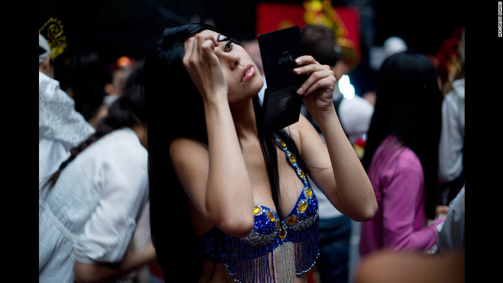 Miss Costa Rica, Silvana Sanchez Jiminez, prepares backstage prior to a rehearsal for the final ceremony.