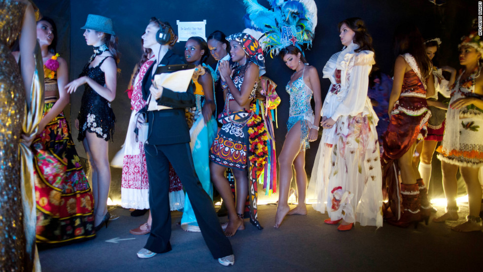Miss World contestants wait backstage before a rehearsal for the final ceremony.