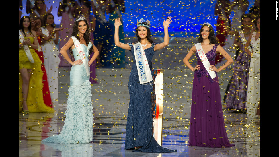 Miss World 2012 winner Yu Wenxia of China waves as she stands next to second place contestent Miss Wales Sophie Moulds, left, and third place Miss Australia Jessica Kahawaty during the pageant's final ceremony.