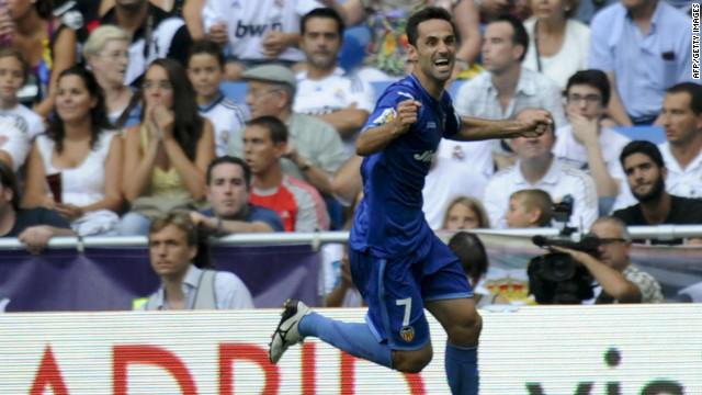 Valencia's Brazilian midfielder Jonas celebrates his equalizing goal in the Santiago Bernabeu Stadium.