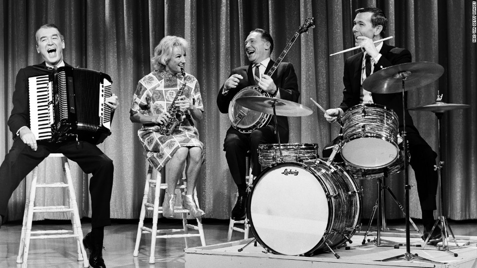 "From left, actor James Stewart, Diller, Los Angeles Mayor Sam Yorty and host Johnny Carson peform on ""The Tonight Show"" in 1964."
