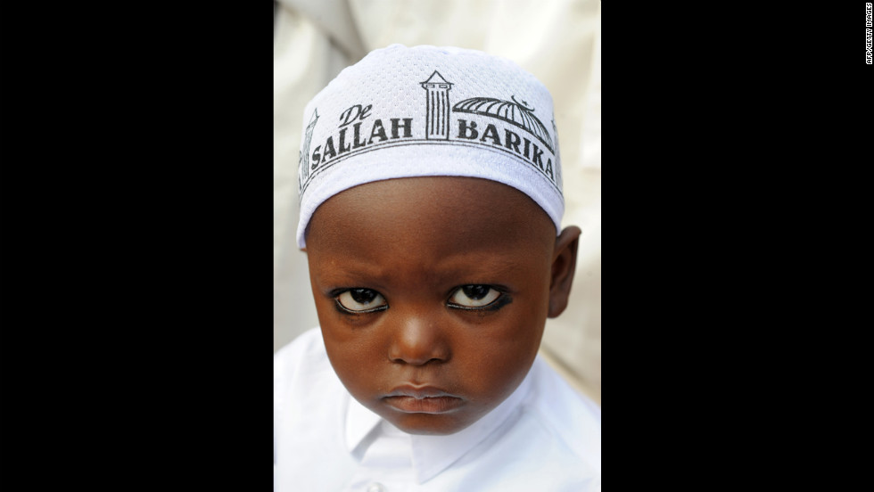 Two-year-old Ahmed Yusuf prays with Muslim faithfuls on the first day of Eid al-Fitr at Obalende praying ground in Lagos, Nigeria, on Sunday.