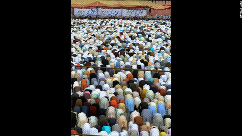 Pakistani Muslims offer Eid al-Fitr prayers in Karachi on Monday.