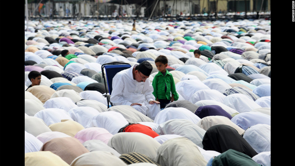 Kashmiri Muslims offer Eid al-Fitr prayers at Hazratbal shrine in Srinagar on Monday.