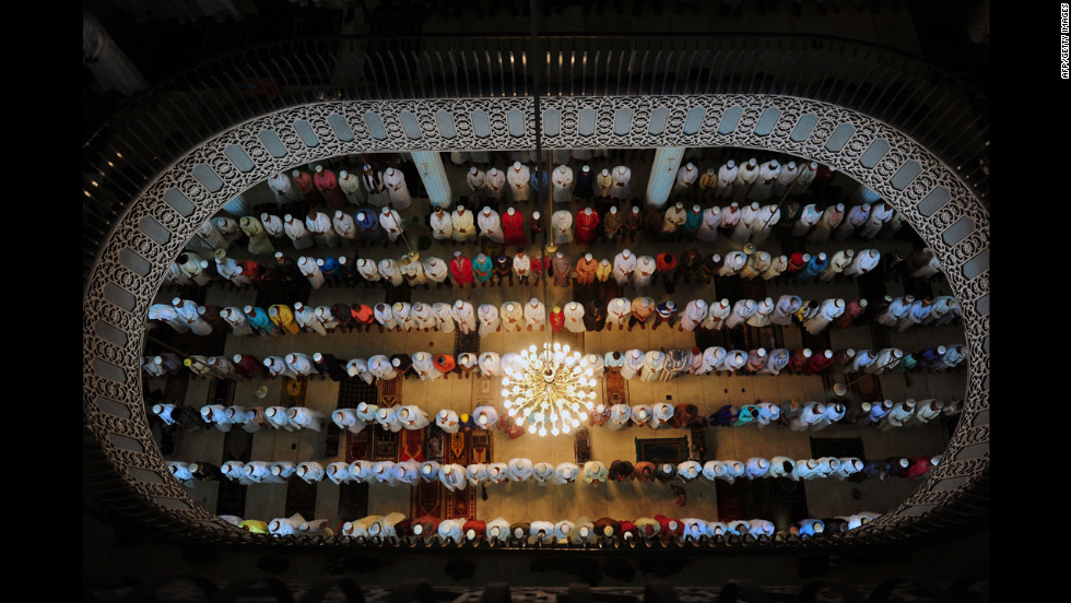 Bangladeshi Muslims offer Eid al-Fitr prayers at the National Mosque of Bangladesh, Baitul Mukarram in Dhaka on Monday.