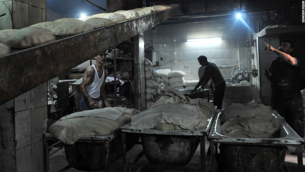 Syrian bakers work in the northern city of Aleppo on Sunday, August 19, the first day of Eid al-Fitr, marking the end of the holy fasting month of Ramadan.