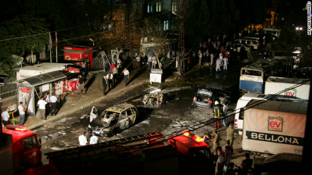 Firefighers and police surround the area where a car bomb went off Monday in the centre of Gaziantep, Turkey.