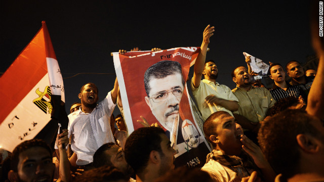 Egyptians celebrate President Mohamed Morsy's dismissal of Field Marshal Hussein Tantawi on August 12 at Tahrir Square.