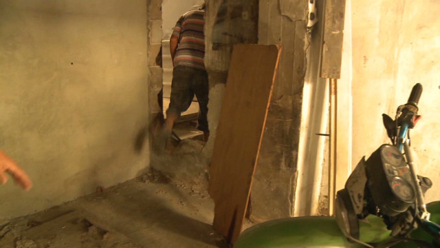 Holes smashed in walls for safe passage