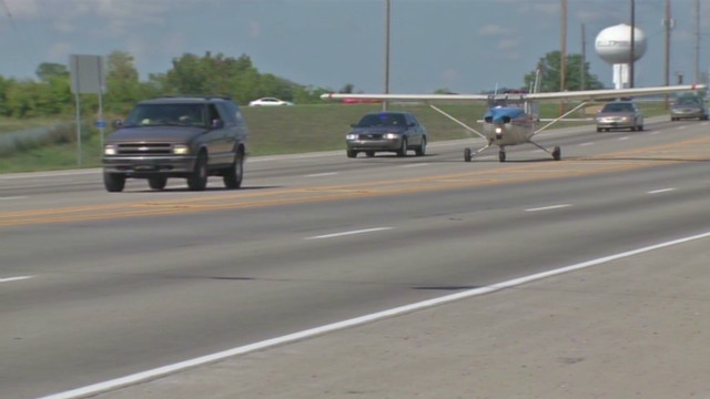 Single-engine plane lands on highway