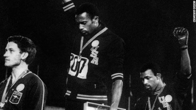 Australian Peter Norman (left) stands alongside U.S. athletes Tommie Smith (C) and John Carlos (R) at the 1968 Olympic Games.