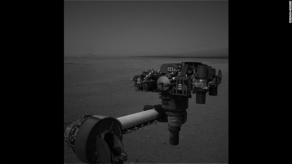 "Curiosity moved its robot arm on August 20, 2012, for the first time since it landed on Mars. ""It worked just as we planned,"" said JPL engineer Louise Jandura in a NASA press release. This picture shows the 7-foot-long arm holding a camera, a drill, a spectrometer, a scoop and other tools. The arm will undergo weeks of tests before it starts digging."