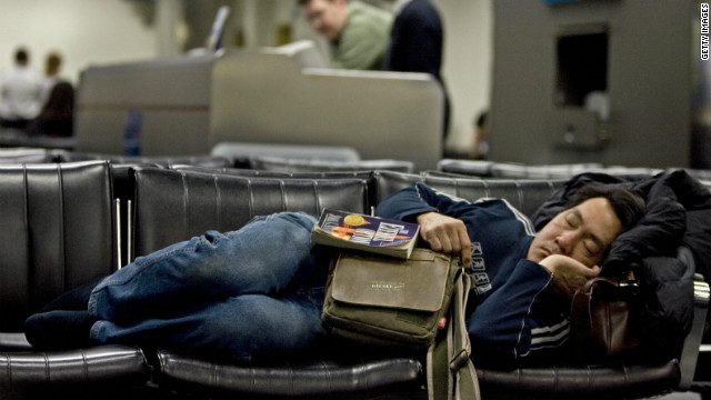 Standby passengers often resort to sleeping in airports while waiting for an open seat on a flight.